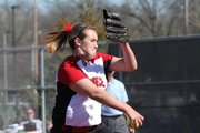 Lawrence High pitcher Lauren Massey winds up to throw to an Olathe North batter on Tuesday, April 5, 2011, at LHS.