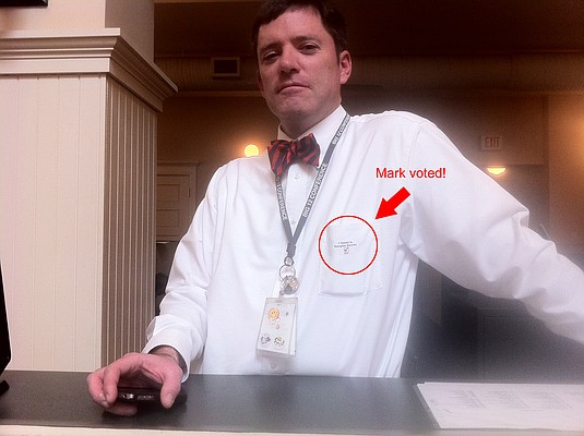 """LJWorld.com reporter Mark Fagan shows off his """"I voted in Douglas County"""" sticker and his special bow tie Tuesday, April 5, 2011, in the News Center, 645 N.H."""