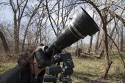 My wife looks through my Canon 7D camera set-up with the 300mm lens with a 1.4x converter. A good sturdy tripod helps keep the focus steady. The nifty lens shade is made from a rubber boot fitting purchase for $6 from Home Depot's plumbing department.