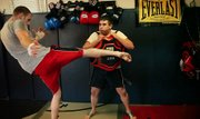 Donavan Kuck, 24, kicks Justin Barstow, 22, as part of MMA practice in a garage in Eudora Thursday, April 7, 2011.