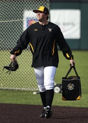Wichita State pitcher — and Lawrence High grad — Albert Minnis collects practice balls before WSU's March 18 game in Wichita. Minnis has served a 30-game suspension since February, missing half of his first college season, after running afoul of an NCAA rule about agents.
