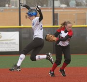 Lawrence High junior second baseman Mallory Reynolds, right, makes the tag on Olathe Northwest's Julie Kern on Thursday at LHS.