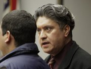 James Calderon, right, translates to a defendant during a court hearing Thursday, April 7, 2011. Calderon is a judicial and medical Spanish interpreter.