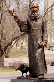 "De Soto High School art teacher Tim Mispagel was commissioned by Benedictine College, his alma mater, to create a sculpture of St. Benedict with the school mascot, a raven. ""I wanted to portray a strong figure,"" Mispagel said. ""St. Benedict was a very centered person, and I wanted to show that in my work; I wanted to avoid any signs of frailty."""