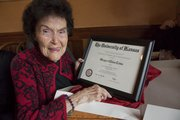 Margaret Eloise Lewis was surprised by her family during a lunch at Teller's Friday when they gave her a framed copy of her diploma. She graduated from Kansas University in 1939 with a degree in economics.