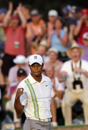 Tiger Woods pumps his fist after a birdie on the 18th hole during the second round of the Masters on Friday, April 8, 2011 in Augusta, Ga.