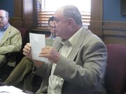 David Merton Shultz on Monday displays documents during a presentation before the State Objections Board in his petition to keep President Obama off the ballot in 2012. Shultz says Obama hasn't provided proof that he is a natural born U.S. citizen.