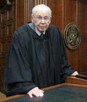 U.S. Federal District Judge Wesley Brown poses in Wichita in this June 4, 2007 file photo. Brown is the oldest working federal judge in the nation, one of four appointees by President Kennedy still on the bench.