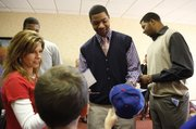 NBA-bound Jayhawks Marcus Morris, center, and brother Markieff Morris sign autographs for Lawrence resident Lori Brungardt and her son Lane, 10, before the KU men's basketball banquet Monday, April 11, 2011 at the Holiday Inn Lawrence.