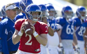 Kansas quarterback Jordan Webb looks over his receivers as he runs through plays with the offense during practice on Monday, April 11, 2011 at the KU practice fields.