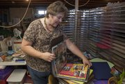 Jamie Knabe has made many scrapbooks for her family in the last 10 years. She closed down her scrapbooking store, Scrappers Paradise in Lawrence's Holiday Plaza, in January.