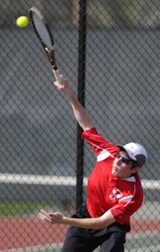 Lawrence High senior Ilan Rosen comes over the top on a serve during a doubles match against Free State on Tuesday, April 12, 2011 at LHS.