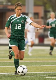 Free State's Regan Keasling breaks away with the ball against Lawrence High on Tuesday, April 12, 2011 at LHS.