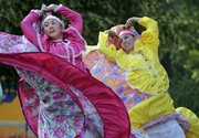 Jessica Bernman, left, and Jessica Garcia were part of the colorful dance group Fiesta Folklorica June 25, 2011, at the St. John&#39;s 29th Annual Mexican Fiesta.