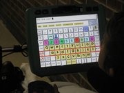 "A KNI resident asks ""How are you?"" with a screen device that she operates by moving her head."