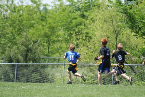 "From Kelly: ""He decided that he wanted to try playing football so we signed him up for flag football in the spring. He only played a couple of games because of school, church and other activities. This picture is him running for a touchdown and he was so pride of what he accomplished."""