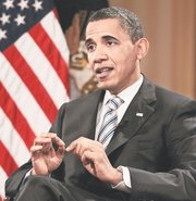 President Barack Obama gestures Friday during his interview with The Associated Press in Chicago.