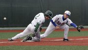 Free State runner Anthony Miele (2) is safe at third in the sixth inning of the Firebirds' game against Springfield (Mo.) Hillcrest on Friday, April 15, 2011, at FSHS in the River City Baseball Festival.
