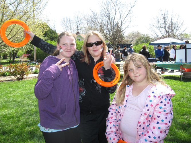 From left, Erica King, 11, Carly McClung, 11, and Abby King, 6, all of Lawrence, enjoy the Earth Day Celebration on Saturday, April 16, 2011, in South Park.
