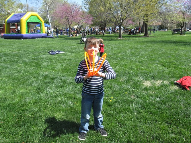 Milo Bitters, 6, of Lawrence, was tossing three Frisbees at a time during the Earth Day Celebration in South Park.