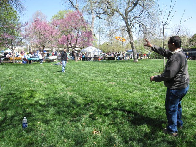 William Bond, left, throws a Frisbee to his father, Billy. They were enjoying the Earth Day festivities in South Park. They both are from Basehor.