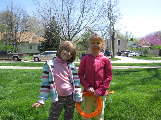 Ava Lee, 4, left, and Lulu Myers-Arenth, 6, both of Lawrence, enjoy the Earth Day festivities in South Park.
