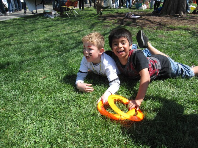 Eli Ditto, 6, left, and Daniel Rojo, 8, both of Lawrence, were playing with Frisbees and chasing each other around South Park during the Earth Day Celebration.