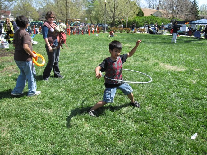 Eight-year-old Daniel Rojo, Lawrence, shows off his hula-hooping talents during the Earth Day Celebration in South Park.