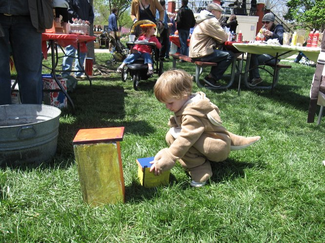 Winslow Parker, 2, of Lawrence, was playing during the Earth Day festivities on Saturday, April 16, 2011, in South Park. His mother is Elizabeth Garrett.