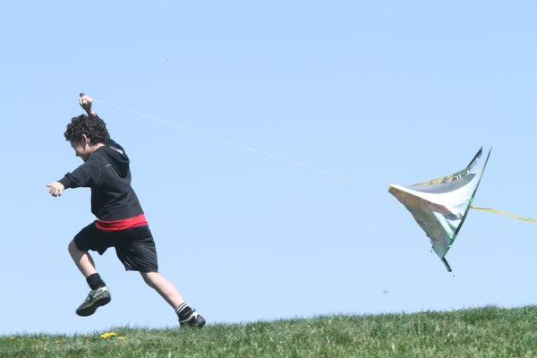 Yoav Gillath, 8, Lawrence, tries to get his kite in the air on  Saturday, April 16, 2011. Outside for a Better Inside, a Lawrence nonprofit, hosted a kite-flying event at Holcom Park.