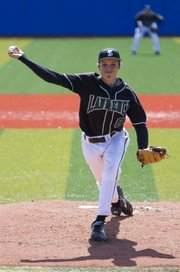 Free State pitcher Trent Johnson delivers a pitch during Free State's game against Rogers (Ark.) High Saturday, April 16, 2011 at Hoglund Ballpark.