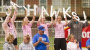 "Kansas softball fans hold up letters that spell out ""Jayhawks!"" during KU's game against Baylor on Sunday, April 17, 2011 at Arrocha Ballpark."