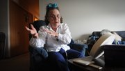 Connie Downey, a former real estate agent who saw her savings erode when she was diagnosed with lung disease sits in her Bellevue, Neb., home April 15, 2011. Downey says she is now on the cusp of qualifying for food stamps.