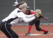 Lawrence High runner Mallory Reynolds takes a lead off first base against Shawnee Mission East on Tuesday, April 19, 2011 at LHS.