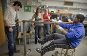 For a project in a Mechanical engineering class, KU students are constructing an exercise machine for people with cerebral palsy who are confined to a wheelchair. Testing their machine  Wednesday in Learned Hall, from left, are KU seniors Alex Porter, Hollie Benson, Katie Sanders and Sakeeb Mehdi.