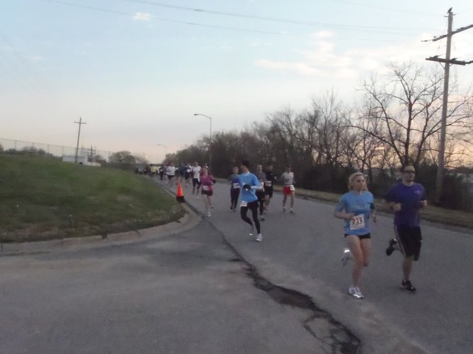 Kansas Half Marathon participants take a wrong turn at the intersection of East Perimeter Road and Shawnee Avenue on Haskell Indian Nations University campus thanks to a sign that had been mistakenly flipped by a spectator.