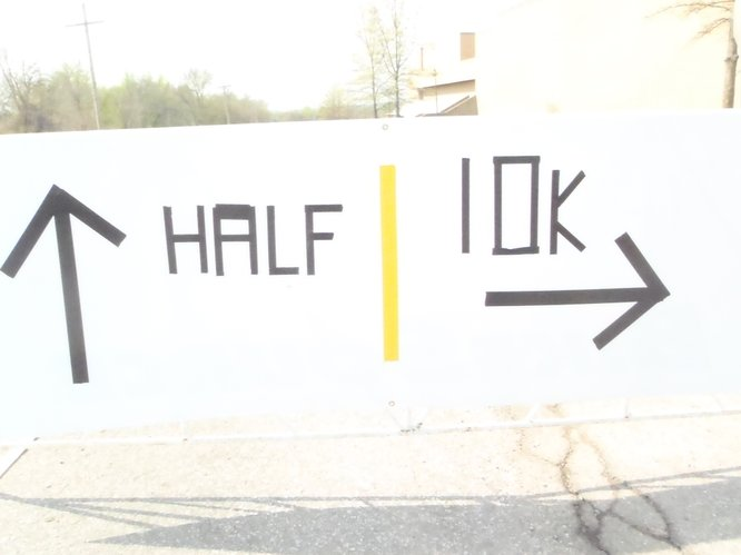 This sign was accidentally flipped around too soon during the Kansas Half Marathon event on Sunday, April 17, 2011, at the intersection of Shawnee Avenue and East Perimeter Road on Haskell Indian Nations University campus. It was only supposed to be used toward the end of the half marathon and 10K courses.