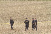 Law enforcement officers protect the scene of a twin-engine plane crash between Topeka and Meriden, in Jefferson County, on Friday, April 21, 2011. Four people were reported to have died in the crash, which happened about noon.