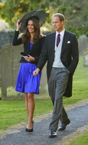 Britain's Prince William and  Kate Middleton leave the wedding of their friends Harry Mead and Rosie Bradford in the village of Northleach, Gloucestershire,  England on Oct. 23, 2010. William and Kate will be married April 29, 2011.