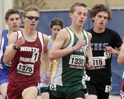 Free State senior Preston Newsome (1330) keeps pace in the boys 1600-meter race Saturday, April 23, 2011 at the Kansas Relays at Memorial Stadium