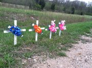 Crosses along the side of Kansas Highway 4, pictured in April 2011, memorialize members of the Spencer family. Dylan Spencer, 35, and his wife, Amy, 34, along with their two daughters, Chase, 7, and Ansley, 5, died when their small plane crashed north of Topeka. The family was from Scott City.