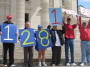 "An awareness campaign by disability service organizations called ""Walk a Mile in My Shoes: Walk Around the World,"" sought to walk 24,902 miles -- the circumference of the Earth -- over a two month period. The effort ended with 128,188 miles, as announced at a rally at the Capitol on Wednesday and displayed by a group that receives services through Lawrence-based Cottonwood Inc."