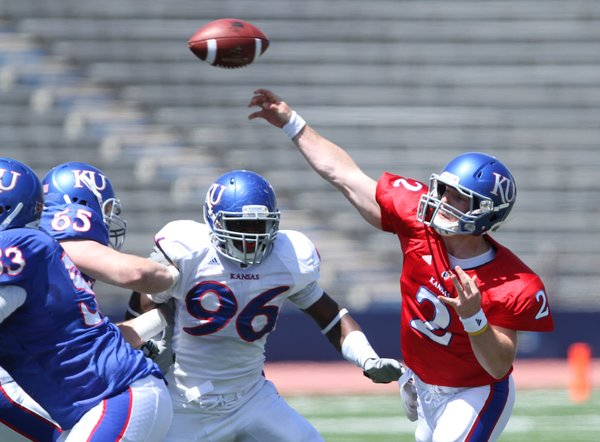 Nick Krug/Journal-World Photo.Kansas quarterback Jordan Webb throws as he is pressured by defensive tackle Keba Agostinho (96) during the Kansas Spring Game on Saturday, April 30, 2011 at Kivisto Field.