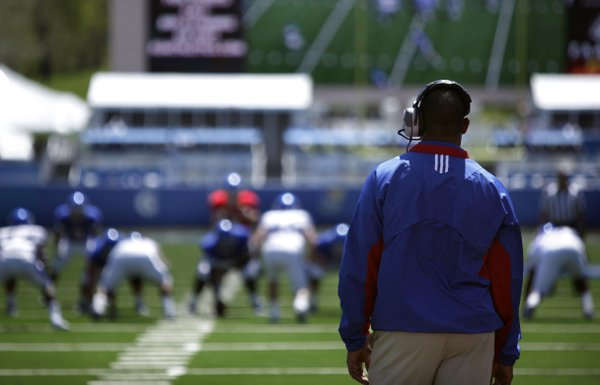 Nick Krug/Journal-World Photo.Kansas head coach Turner Gill watches the action from the endzone during the Kansas Spring Game on Saturday, April 30, 2011 at Kivisto Field.