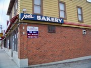 The neon sign from Lawrence landmark Joe's Bakery is the newest addition to the KU Memorial Unions KU History Collection. Crews from Full Bright Sign & Lighting removed the famous sign from the building March 9, 2011.