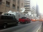 Media satellite trucks line up for blocks on Church Street near Ground Zero Monday, May 2, 2011, the day after Osama bin Laden&#39;s death in Pakistan was announced.