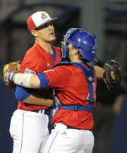 Kansas catcher James Stanfield congratulates reliever Frank Duncan after the final out of the ninth inning against Wichita State on Tuesday, May 3, 2011 at Hoglund Ballpark. The Jayhawks defeated the Shockers 7-4.