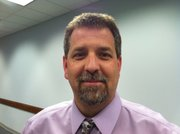 Frank Harwood, a former Lawrence school district employee and Kansas University grad, has been offered the position of superintendent of De Soto schools.