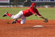 Lawrence High shortstop Corbin Francisco makes a diving catch for an out during Lawrence Highs game against Shawnee Mission Northwest Wednesday, May 4, 2011 at LHS. The Lions lost, 5-3.
