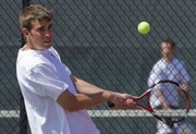 Connor Schmidt tries his backhand in double match Wednesday as Lawrence High plays Mill Valley at home.